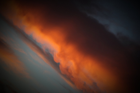 unusual angle: Burning orange cloud in sunset in unusual angle.