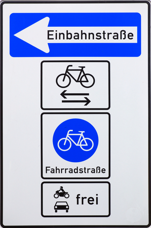 accessed: German traffic sign indicating a special one-way road, which is mainly a bike road, but may be accessed by motorists. Stock Photo