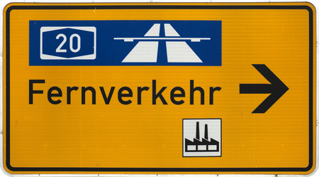 German road sign showing the way to the next Autobahn, industrial area and general long-distance traffic routes. photo