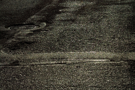 image created 21st century: Sunlight reflections on wet asphalt. Stock Photo