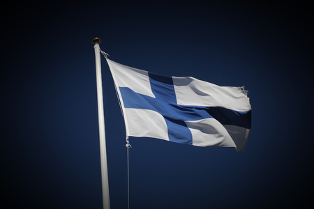 image date: Flag of Finland on dark blue sky. Vignetting was added.