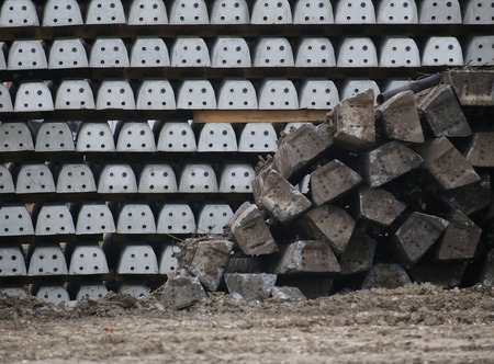 image date: Old and new concrete railroad ties waiting for installation.