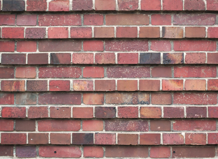 prominence: Red brick texture in layers with different prominence.