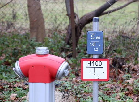 fire hydrant: Fire hydrant with sign in Germany. Stock Photo