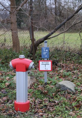 image date: Fire hydrant with sign in Germany. Stock Photo