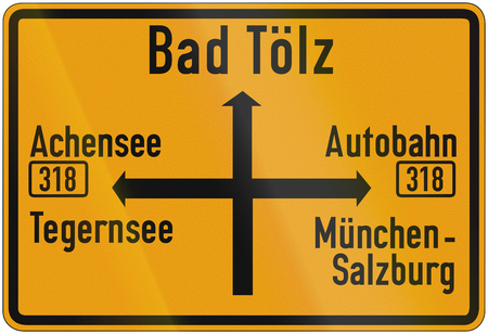 autobahn: Old design (1956) of a German direction sign on a federal road showing the way to Bad Toelz and different other towns. Autobahn means highway. Stock Photo