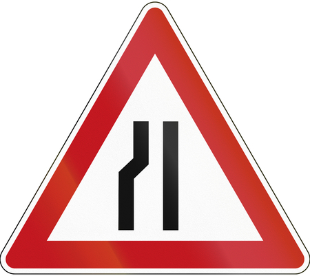 red handed: German sign indicating narrowing of the road only on the left. Stock Photo