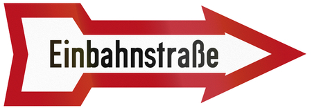 Old design (1934) of a German one-way road sign. Einbahnstrasse means one-way road. photo