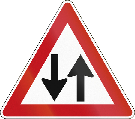 opposing: German sign warning about opposing traffic on a two-way road. Stock Photo