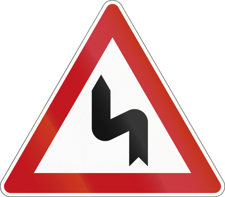 image date: German sign warning about a left curve.