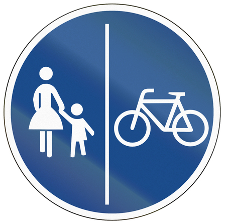daughter in law: German traffic sign on a shared-use path with separate lanes, left lane for pedestrians and right lane for bicycles.