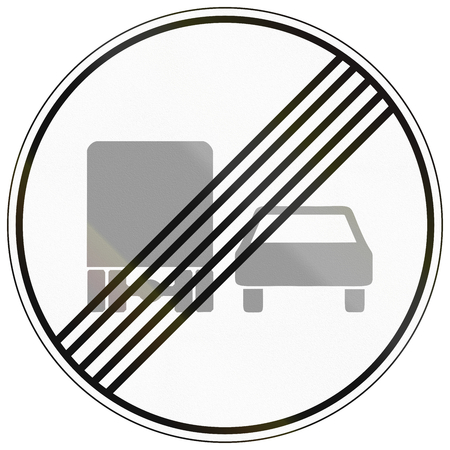 German traffic sign: End of no overtaking by lorries zone. photo