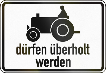 German traffic sign additional panel to specify the meaning of other signs: Slow vehicles (e.g. tractors) are allowed to be passed. Duerfen ueberholt werden means: are allowed to be passed. photo