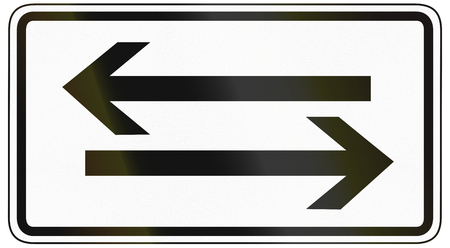 specify: German traffic sign additional panel to specify the meaning of other signs: Crossing road both ways. Stock Photo