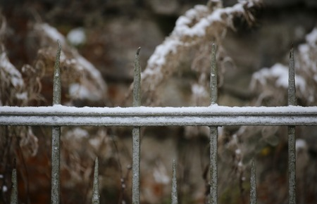 metal fence: Snow of an old fashioned metal fence.