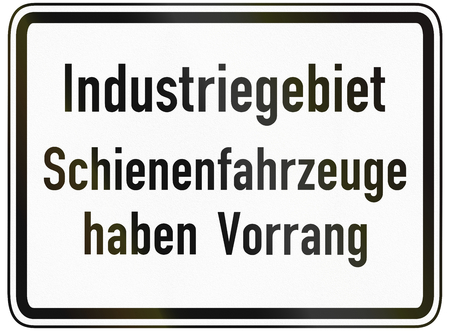 image date: German traffic sign additional panel to specify the meaning of other signs: Industrial area - Trains have priority.