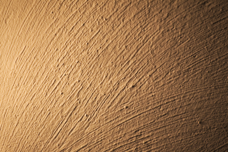 image date: Brush marks on an illuminated white wall.