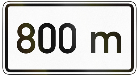 specify: German traffic sign additional panel to specify the meaning of other signs: 800 meters ahead. Stock Photo