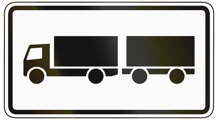 specify: German traffic sign additional panel to specify the meaning of other signs: Lorries with trailer only.