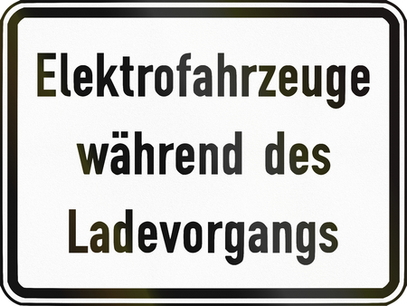 specify: German traffic sign additional panel to specify the meaning of other signs: Electric vehicles being charged. Stock Photo