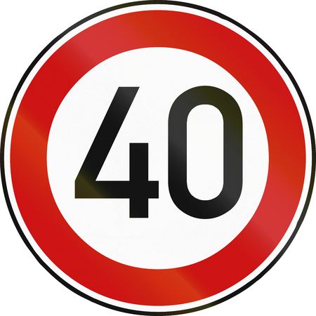 restricting: German traffic sign restricting speed to 40 kilometers per hour. Stock Photo