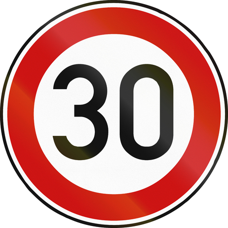 restricting: German traffic sign restricting speed to 30 kilometers per hour.