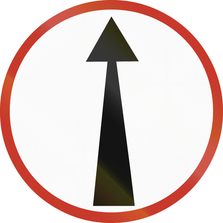 restricting: Old design (1953) of a German sign restricting the driving direction to straight forward. Stock Photo