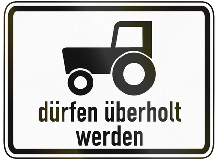 sentencing: German traffic sign additional panel to specify the meaning of other signs: Slow vehicles (e.g. tractors) are allowed to be passed. Duerfen ueberholt werden means: are allowed to be passed. Stock Photo