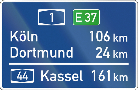 distances: German sign showing destinations and distances.