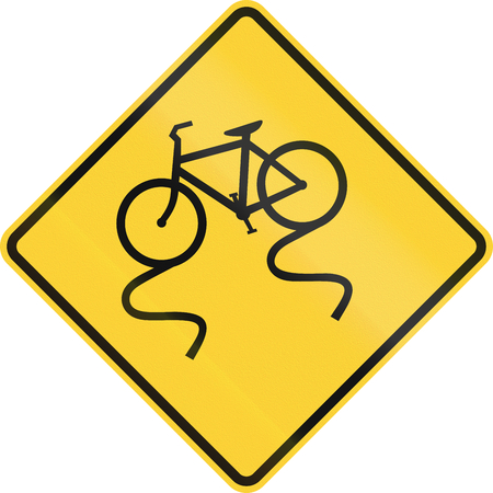 skidmark: US road warning sign: Slippery when when with bicycle Stock Photo