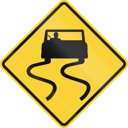 skidmarks: US road warning sign: Slippery when wet Stock Photo