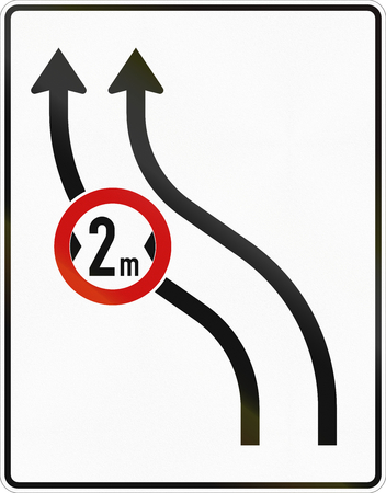 red handed: German traffic sign: Deviation of two lane road to the left. Another traffic sign is integrated: maximum width of 2 meters on the left lane. Stock Photo