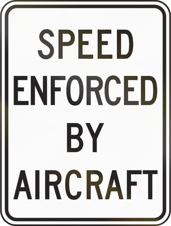 enforced: United States speed enforced by aircraft sign, California Stock Photo