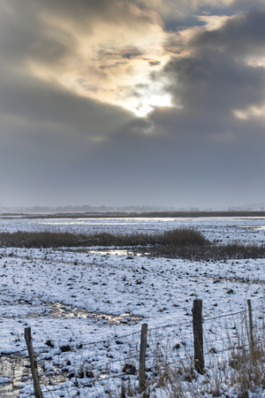 greifswald: Nature reserve on the Karrendorfer Wiesen near Greifswald, Mecklenburg-Vorpommern, Germany, in winter. The image was created using a HDR imaging technique to emphasize the cloudscape.