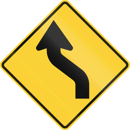 handed: US road warning sign: Reverse curve