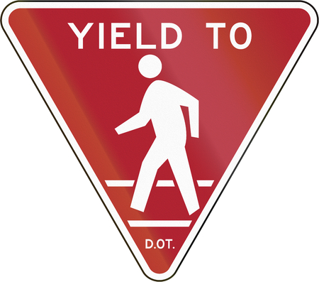 United States traffic sign: Yield to pedestrians, New York City Stock Photo