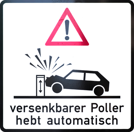 automatically: German warning sign: immersible bollard rises automatically.