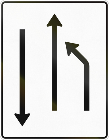 German road sign: Turn to other lane. Oncoming traffic is shown. Stock Photo