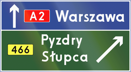 Polish direction sign at motorway exit, stack type. photo