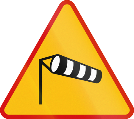 red handed: Polish sign warning about a left curve.