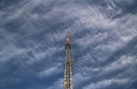image created 21st century: Red and white radio tower in unusual angle