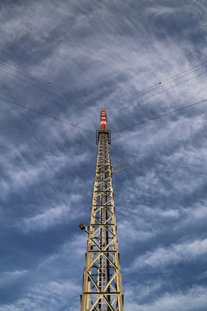 unusual angle: Red and white radio tower in unusual angle