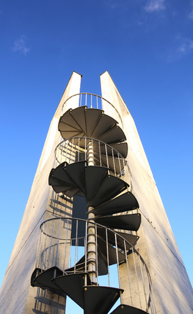 medium shot: Lookout tower with spiral staircase seen from below.