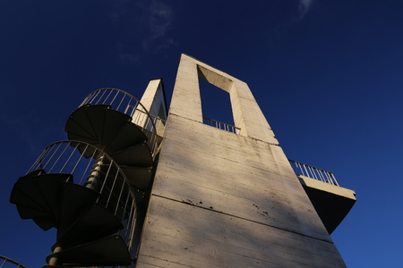 polarization: Lookout tower with spiral staircase seen from below. The sky is darkened due to the use of a polarization filter.