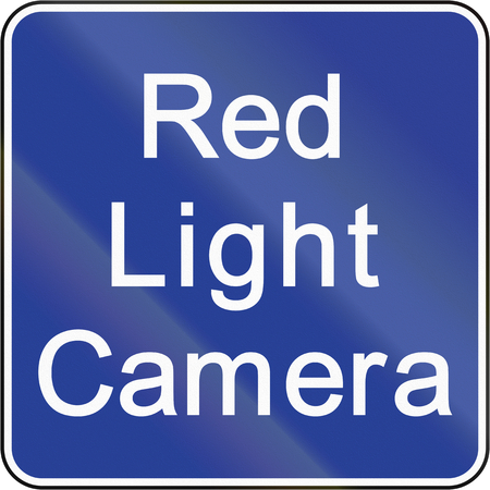 Road sign in Brunei: Red light camera photo