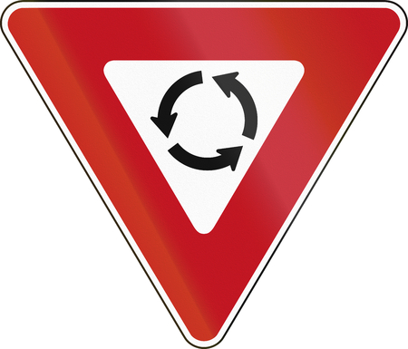 yield: Canadian States traffic sign: Yield At Roundabout