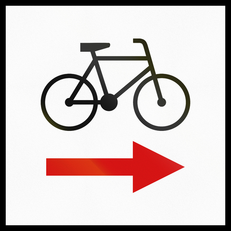 red handed: Polish informational sign: Change in direction of regional cycle route Stock Photo