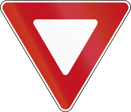 yield sign: Canadian States traffic sign: Yield At Roundabout