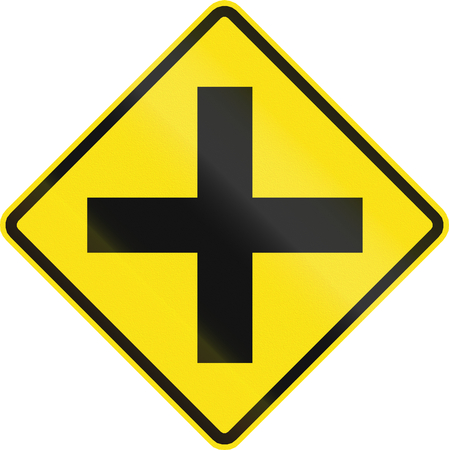 routing: Chilean road warning sign: 4-way Intersection ahead Stock Photo