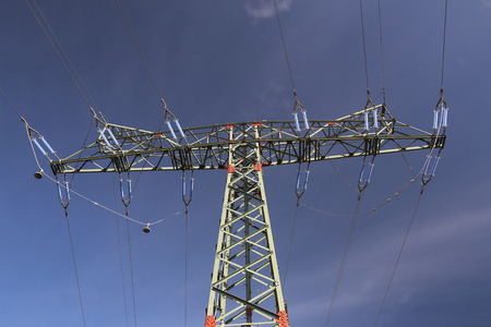 image created 21st century: View of a high voltage line pylon and dark blue sky from below.